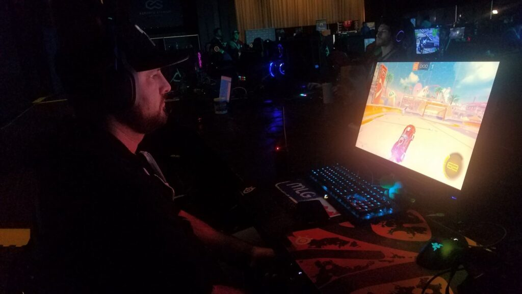Man playing video game at a gaming event